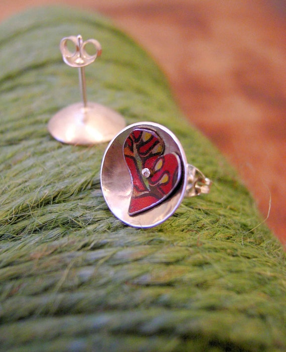 Folksy Red. Heart stud earrings featuring recycled tins in silver.