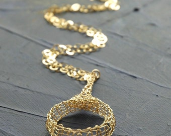 Ethnic crocheted  large  circle necklace in gold
