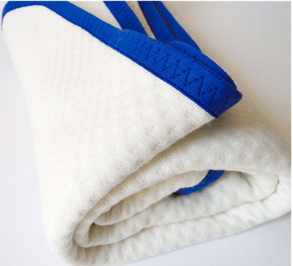 Luxurious quilted termal organic cotton blanket  for baby, toddler or child with Royal Blue trim
