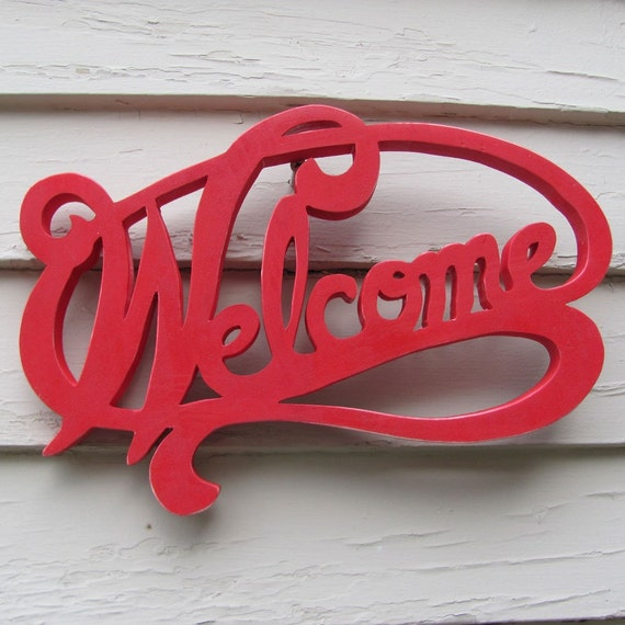 wooden fretwork welcome sign