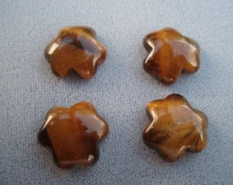 4 large Tiger Eye beads