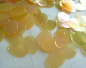 7g of Flat Oval Sequins in Light Orange Iridescent Color -- 12x9mm (approximately 290 ct.)