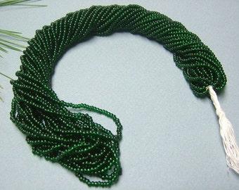 One hank of Czech Transparent Dark Green seed beads - 0407 size 10