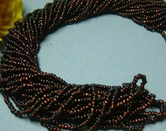 One hank of Czech Silver Lined Root beer seed beads - 1004 size 11