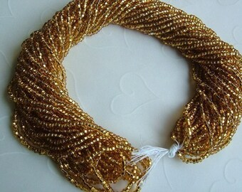 One hank of Czech Gold Color Silver Lined Seed Beads - 1009 size 11