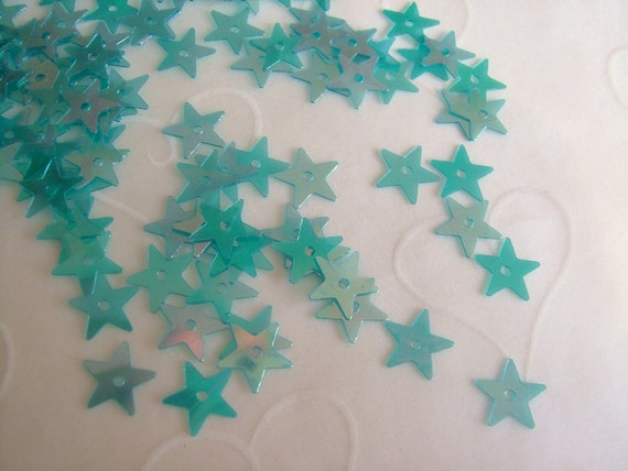 7g of 7 mm Little Star Sequins in Teal Iris Color