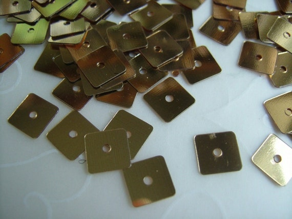 7 g of 7mm Square Sequins in Metallic Gold color (approximately 400 ct.)