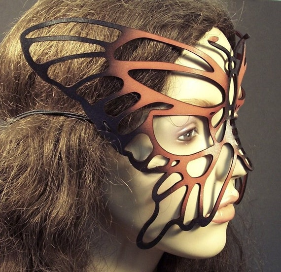 Butterfly mask in cut out leather -- orange and black
