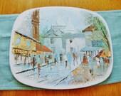Vintage street scene metal trivet hot plate