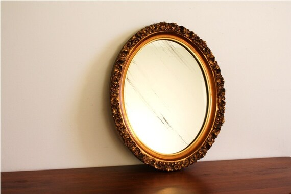 Antique oval mirror with gold wood frame
