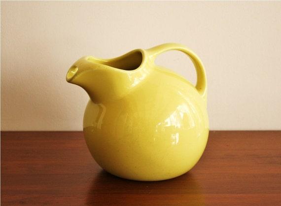 Vintage yellow Hall's pitcher, ball jug