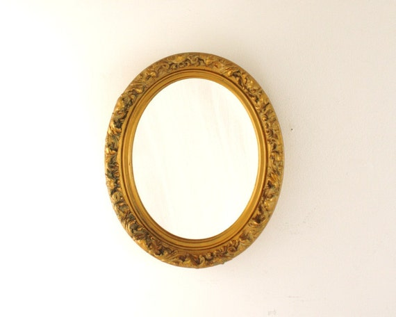 Antique gold oval wooden mirror