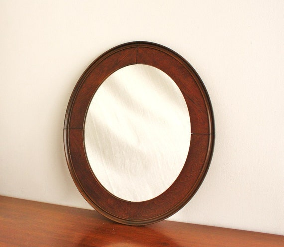Vintage oval mirror with solid wood frame