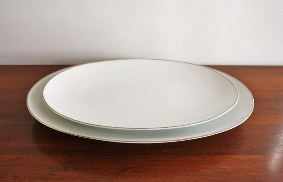 Pair of porcelain platters with silver trim, Bavaria Germany