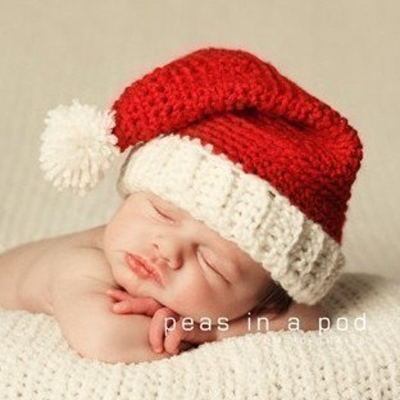 This infant size plush Santa Hat is the perfect addition to your Christmas party. The red plush is trimmed with a thick white fur and has a large white fur pom pom at the top.