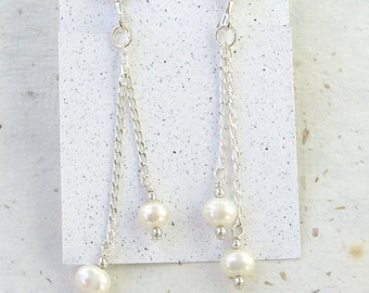 Dangling pearl and silver clip earrings