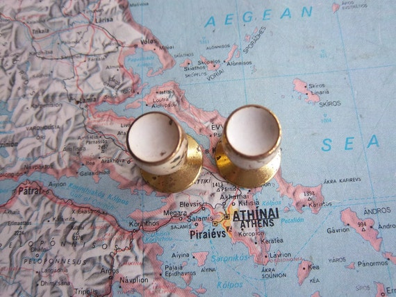 2 small vintage mid century distressed brass metal knobs with white centers includes hardware