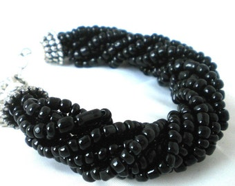 Handbeaded bracelet with black glass beads