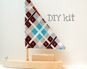 DIY toy sailboat with blue and brown checked sail