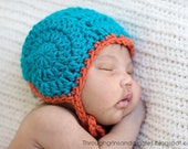 The snail helmet, pilot cap with ties for the newborn.  Snug fit, hand crocheted.