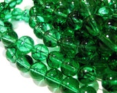 CLOSING SHOP - 25  emerald green beads with black streaks - glass - 8mm B487