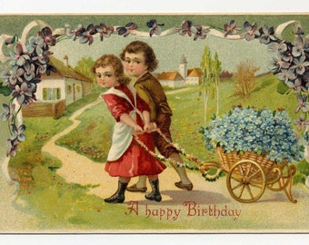 A Happy Birthday Postcard - Children With Cart Full Of  Forget Me Nots