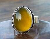 A piece of golden sun Opalite ring