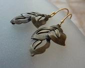 ON SALE 15% OFF Leaf earrings. Leaf shape dangle earrings. gold earwires. sterling silver.