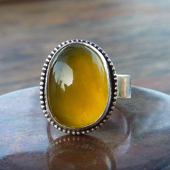 A piece of golden sun Opalite ring