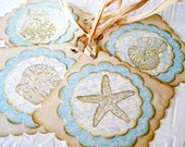 Seashell Tags hand stamped seashells starfish soft blue khaki sand sepia brown raffia ties