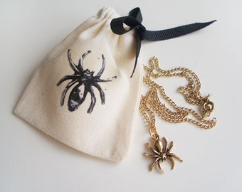"Mini spider gold necklace (16"") with matching pouch"