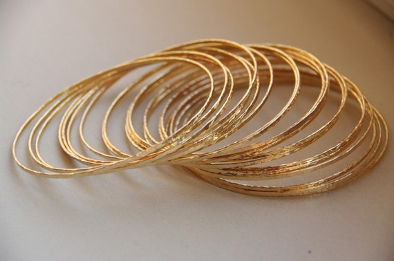 Set of 5 thin 14k gold filled hand hammered stack bangles - Eco friendly stacking bangles - bangles