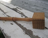 large wooden tenderizer
