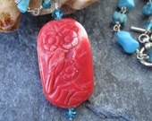 Turquoise, magnasite, red coral, and sterling silver necklace