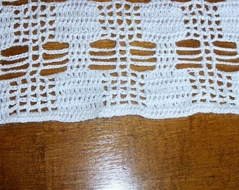 White crocheted RV-sized tablecloth