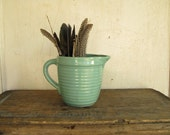 light turquoise stoneware pitcher