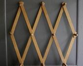 vintage wooden accordian peg rack