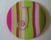 pink and green J pin