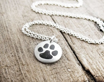 Tiny cat paw print necklace in silver