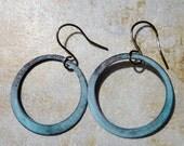 Handmade with handmade copper enameled hoop earrings