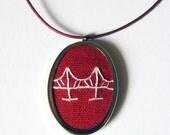 Red bridge pendant hand embroidered on organic cotton canvas