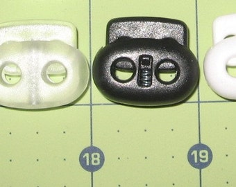 """25 1"""" toggles bean 2 hole cord locks( white, black, frost or a mix)"""
