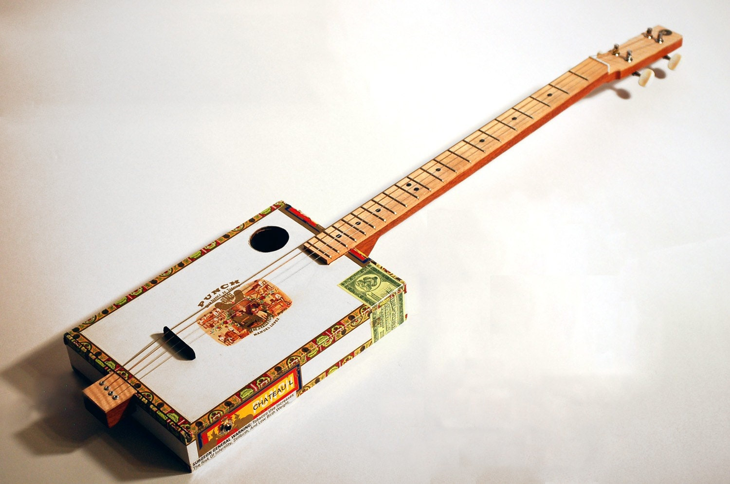 String fretted cigar box guitar with piezoelectric by kwithrow