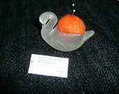 Hand felted wool pincushion nestled  in a glass swan