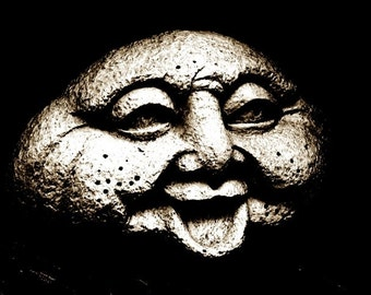 Laughing Face with Emotion on Black background - Pessimism - a photograph of a stone statue with a dark expression - fine art photograph