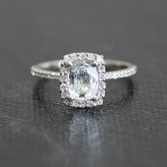 Cushion white sapphire in a 14k white gold diamond ring