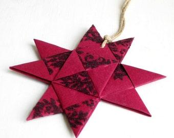 Star, paper, ornament origami textured, dramatic dark purple red Christmas