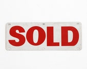 metal sold sign