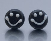 Stud earrings - Smile :-)  Black and white - lampwork glass and sterling silver by Jennie Yip