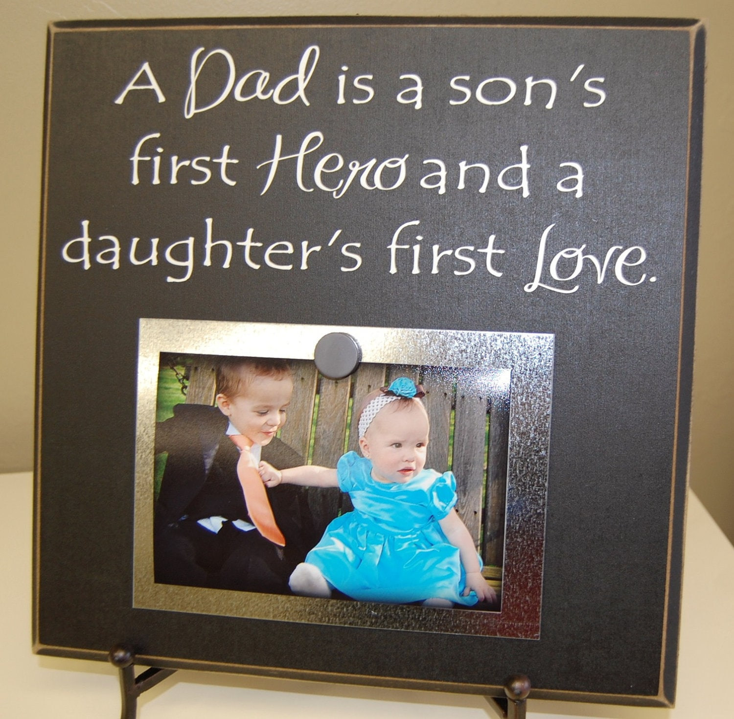 Download A Dad is a son's first hero and a daughter's first